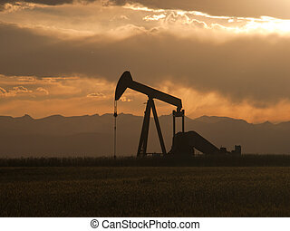 A pumpjack silhoutte with dramatic sunset.