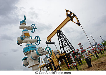 Pumpjack and oilwell. - Extraction of oil. pumpjack and...