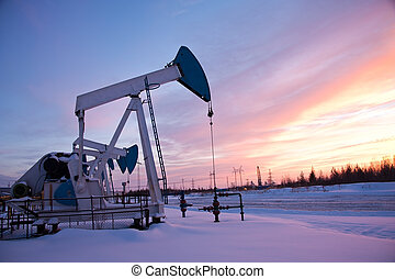 oil pump on the sunset sky background