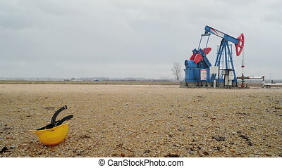 Pumpjack Oil Pump operating on natural gas in the field pumping from the oil well. 1920x1080 full hd footage.