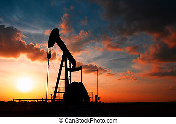 Pump jack with colorful sunset