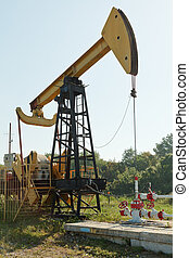 pumpjack pumps oil in foothills of Caucasus mountain
