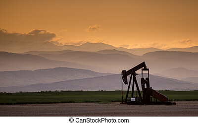 Pumpjack With Contours of the Rocky Mountains