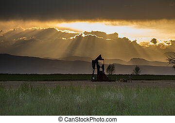Pumpjack With Crepuscular Rays