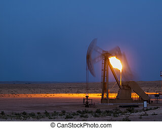 Pumpjack with flame at Pawnee National Grassland in Weld County, of northeastern Colorado.