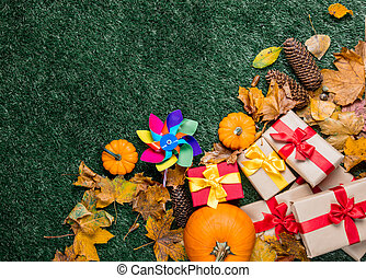 Pumpkin and autumn season leaves with pinwheel toy