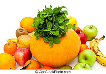pumpkin and lots of different tropical fruits on a white background