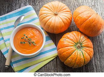 pumpkin soup  - pumpkin and pumpkin soup on a wooden surface
