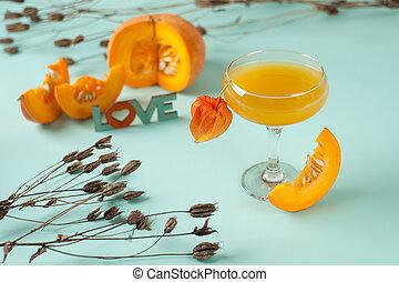 pumpkin autumn cocktail on blue background