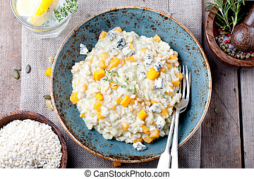 Pumpkin, blue cheese risotto in a ceramic plate - Pumpkin, ...