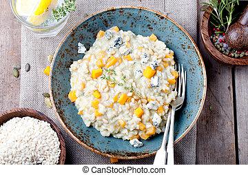 Pumpkin, blue cheese risotto in a ceramic plate - Pumpkin, ...
