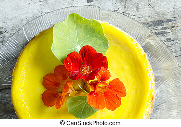 Pumpkin cheesecake decorated with fresh flowers. From the ...