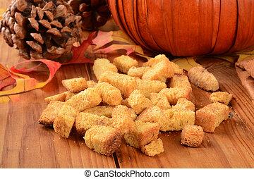Pumpkin cornbread croutons - A mound of pumpkin cornbread...