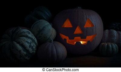 Pumpkin Face Glowing In Dark Room Loop
