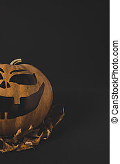 pumpkin for halloween and dried leaves