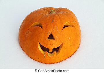 Pumpkin for halloween on a snow