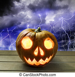 Pumpkin head for Halloween on the background of a stormy sky