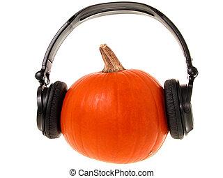Pumpkin wearing a set of headphones.
