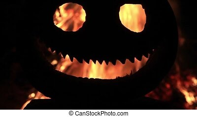 pumpkin head with a fire in the eyes and mouth