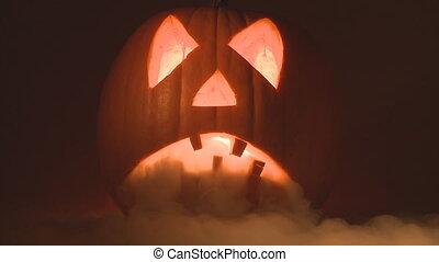 spooky halloween pumpkin breathing heavy smoke close
