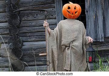 pumpkin horror head monster with a scythe