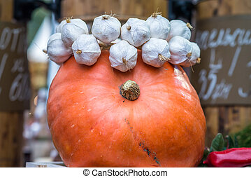 pumpkin is decorated with garlic