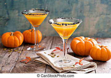 Pumpkin martini cocktail with black salt rim - Pumpkin...