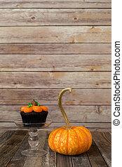 Pumpkin muffin with ornamental fall gourd