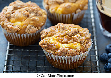 Pumpkin muffins with cheesecake filling on a cooling rack