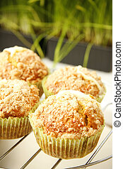 Pumpkin muffins with fresh cheese filling in kitchen