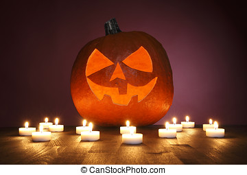 Pumpkin on a red background with candles