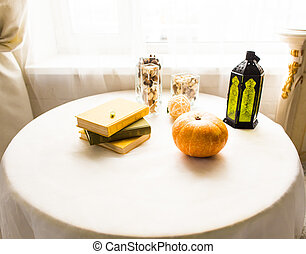 Pumpkin on the table, autumn and halloween concept