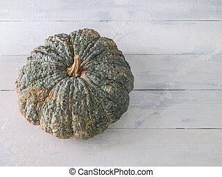 Pumpkin on white wooden background