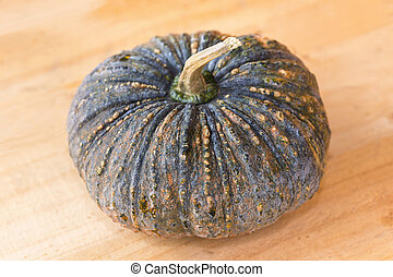 Pumpkin on wood background