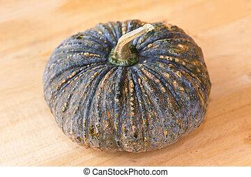 Pumpkin on wood background