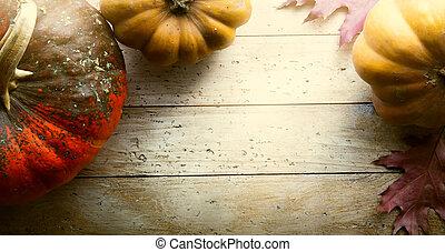 Pumpkin on wooden background; thanksgiving art