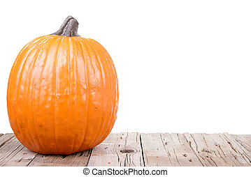 pumpkin on wooden plank