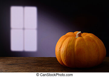 pumpkin on wooden table with window light
