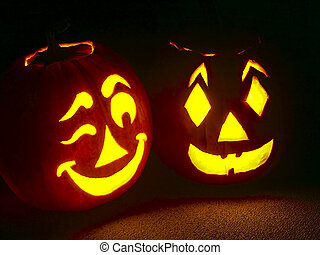 Two pumpkin jack-o-lanterns sit on a porch with one winking.