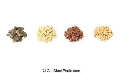Pumpkin, peanut, linseed, pine seeds on white