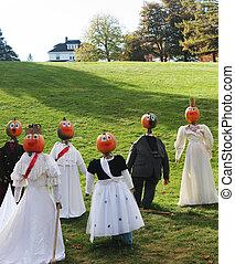 Pumpkin people gathering.