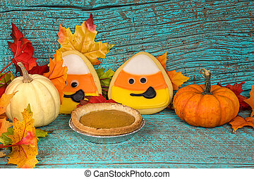 pumpkin pie and cookies with fall leaves
