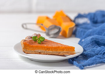 Pumpkin pie Homemade dessert Autumn delicious. Piece of traditional cake with cut pumpkin on white wooden background. Vegetarian food. Horizontal banner for thanksgiving, fall congratulation card