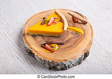 Pumpkin pie on a wooden board