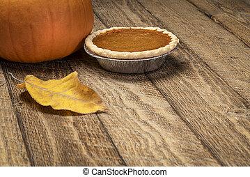 pumpkin pie on rustic wooden table