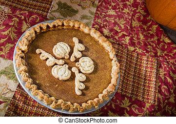 Pumpkin pie overhead with cloth