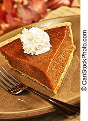 Pumpkin pie - Slice of pumpkin pie with fresh whipped cream