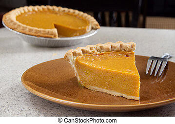 pumpkin pie slice - one slice of pumpkin pie removed from...