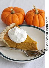 Pumpkin Pie Slice - Vertical - A slice of pumpkin pie with...