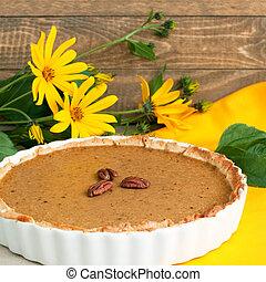 pumpkin pie - Home baked pumpkin pie in ceramic dish and...